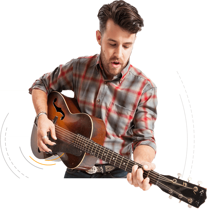 Musician playing guitar with Tone Tips removable finger picks