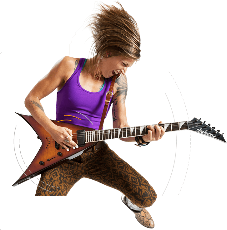 Musician playing a flying V guitar with Tone Tips removable finger picks
