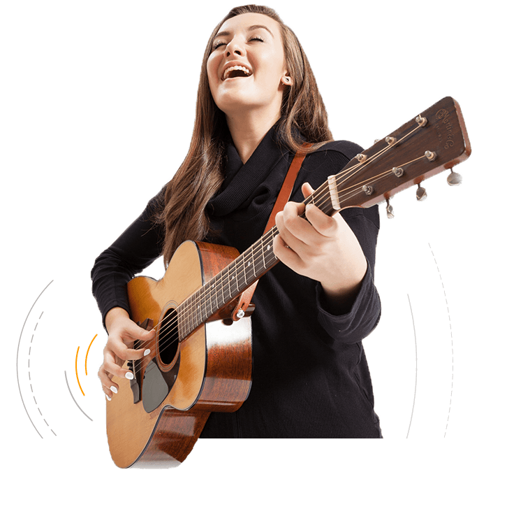 Woman singing and playing guitar with Tone Tips removable finger picks
