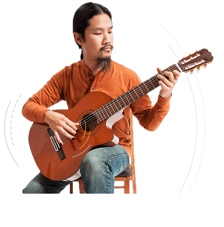 Musician playing classical guitar with Tone Tips removable finger picks