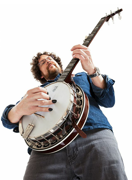 Photo of a musician playing banjo with Hybrid Tone Tips removable finger picks