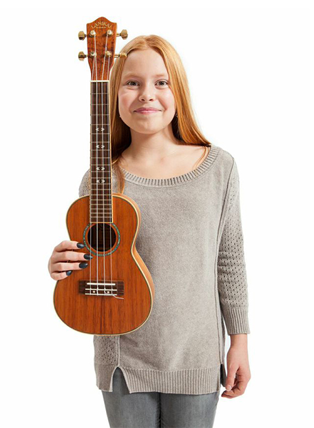 Photo of young ukulele player wearing Tone Tips Hybrid removable finger picks