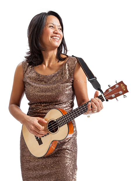 Photo of woman ukulele player playing with Tone Tips removable instrument picks